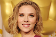 Presenter Scarlett Johansson poses in the press room during the 83rd Annual Academy Awards held at the Kodak Theatre on February 27, 2011 in Hollywood, California.