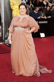 Melissa McCarthy dazzled in a mauve evening gown with embellished detailing.