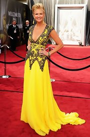 Nancy O'Dell was a vision in bright yellow, wearing a vibrant gown complete with intricate lace detailing.