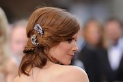 Kate Mara attended the 84th Annual Academy Awards wearing her hair in lengthy pinned-up twists with lovely silver accents.