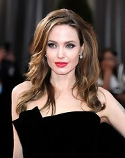 Angelina Jolie attended the 84th Annual Academy Awards wearing her hair in soft wind-blown waves.