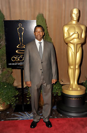 Denzel Washington played it safe on the red carpet with a classic tan suit.