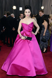 Fan Bingbing popped on the red carpet in a hot pink gown with a full skirt and asymmetrical neckline.
