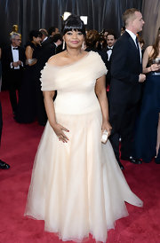 Octavia Spencer stunned at the 2013 Oscars in a blush tulle gown with a hand-beaded bodice and lace underlay.