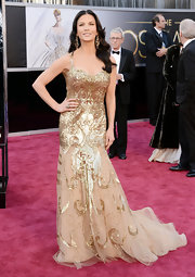 Catherine Zeta Jones looked as gold as an Oscar statue in an embroidered beaded mermaid gown.