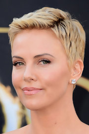 Charlize Theron kept her look soft and feminine with high-shine pink lips.