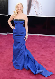 A royal blue strapless gown with black trim on the bodice simply popped on Reese Witherspoon at the 2013 Oscar red carpet.