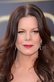 Marcia Gay Harden looked fabulous wearing dangling ruby earrings at the Oscar Awards 2013.