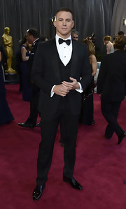 Channing Tatum traded in his casual look for a very dapper black satin shawl lapel, two button tuxedo for the 2013 Oscars.