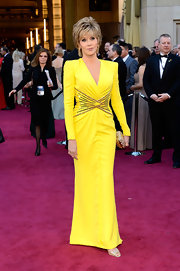 Jane Fonda proved she can still rock a red carpet with this canary yellow long-sleeve gown with gold embellishments around the waist.