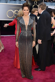 Halle Berry showed her modern side at the 2013 Oscars with a silver striped sequin gown and a plunging neckline.