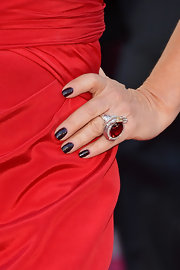 Marcia Gay Harden had her nails painted with black polish for the Oscar Awards.