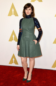Felicity Jones wore a gorgeous khaki green leather dress for the Academy Awards Nominee Luncheon.