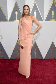 Louise Roe went for ultra-feminine appeal in a strapless peach ruffle gown by Christian Siriano for her Oscars look.
