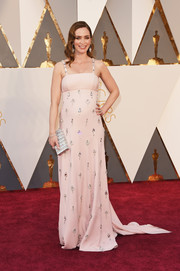 Emily Blunt charmed in a vintage-inspired pale-pink Prada gown at the Oscars.