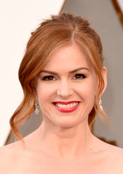 Isla Fisher sweetened up her look with this wavy ponytail for the Oscars.