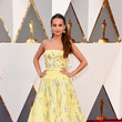 Alicia Vikander (in Louis Vuitton) as Belle