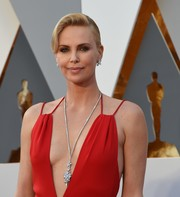 Charlize Theron complemented her plunging neckline with a diamond pendant necklace by Harry Winston when she attended the Oscars.