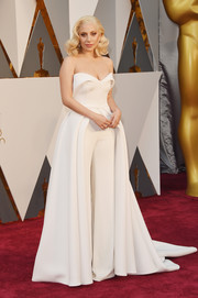 Lady Gaga showed us how to look ultra glam in pants with this white Brandon Maxwell strapless gown and trousers hybrid during the Oscars.