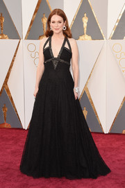 Julianne Moore oozed gothic glamour at the Oscars in a black Chanel lace gown with a strappy neckline.