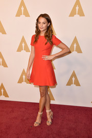 Alicia Vikander styled her dress with embellished nude ankle-cuff sandals.