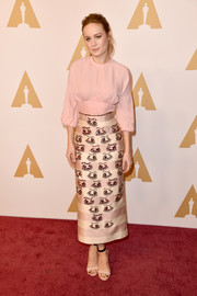 Brie Larson kept it modest yet stylish in a blush-colored blouse by Emilia Wickstead during the Academy Awards nominee luncheon.