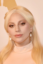 Lady Gaga played up her eyes with a heavy application of gold shadow for the Academy Awards nominee luncheon.