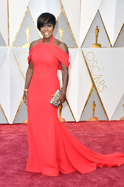 Viola Davis brought a vibrant pop to the Oscars red carpet with this coral cold-shoulder gown by Armani Prive.