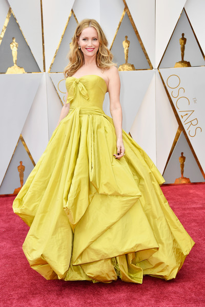 Leslie Mann (in Zac Posen) as Belle