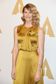 Laura Dern showed off a modern and chic Fernando Jorge cuff bracelet at the Academy Awards nominees luncheon.
