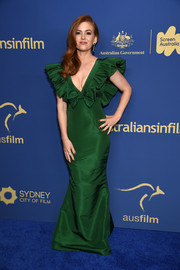 Isla Fisher dolled up in a green Alexia Maria column dress with ruffled sleeves and bow detailing for the Australians in Film Awards Gala.