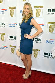 Actress Yvonne Strahovski attended the 8th Annual BAFTA/LA TV Tea Party wearing 18-karat gold and onyx Universe ring.