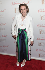 Lena Dunham jazzed up her look with a pair of printed tie-waist pants by Tanya Taylor.