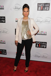 Alicia Keys shined on the red carpet at the Keep A Child Alive Black Ball. She topped off her outfit with gold and black cap toe pumps.