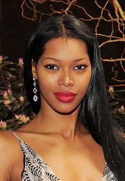 Bombshell Jessica White paired her bright red pout with groomed eyebrows and smoky eyes.