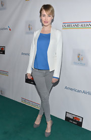 A classic white blazer made Dominique McElligott's look polished and clean at a pre-Oscar party.