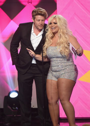 Trisha Paytas spoke onstage at the 2018 Streamy Awards wearing a glittering silver romper.