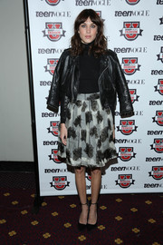 Alexa Chung played with opposites at the Teen Vogue University, teaming a girly black-and-white floral skirt with an edgy biker jacket.