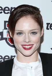 Coco Rocha made sure she still looked very feminine despite the short 'do by wearing a rich red lip color at the Teen Vogue University.