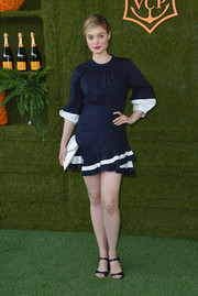 Bella Heathcote went nautical-chic in this navy and white mini dress by Tanya Taylor at the Veuve Clicquot Polo Classic.