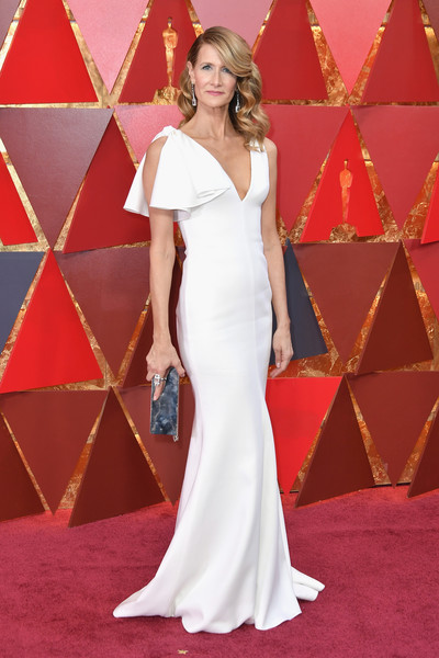 Laura Dern styled her dress with an industrial-chic silver clutch by Calvin Klein.