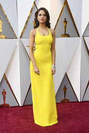 Eiza Gonzalez brought a dazzling pop of color to the 2018 Oscars red carpet with this canary-yellow halter gown by Ralph Lauren.