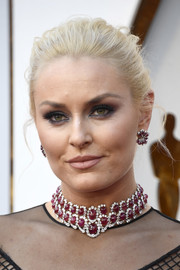 Lindsey Vonn teamed her stunning necklace with matching ruby and diamond earrings.
