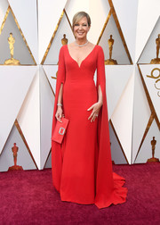 Allison Janney cut a regal figure in a red Reem Acra gown with floor-length sleeves at the 2018 Oscars.