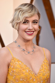 Greta Gerwig accessorized with a vintage 1910 moonstone collar necklace designed by Louis Comfort Tiffany.