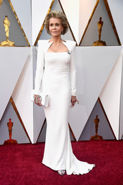 Jane Fonda complemented her gown with a crystal-embellished white clutch by Perrin Paris.