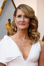 Laura Dern polished off her look with a pair of dangling earrings by Atelier Swarovski.