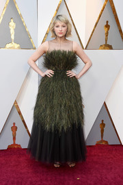 Haley Bennett worked a queen-of-the-meadow look with this feathered green and black gown by Dior Couture at the 2018 Oscars.