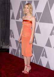 Saoirse Ronan rounded out her colorful ensemble with pink velvet sandals by Rupert Sanderson.