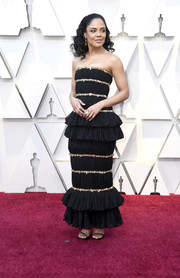 Tessa Thompson looked ultra girly in a strapless Chanel Couture gown with gold trim and ruffle detailing at the 2019 Oscars.